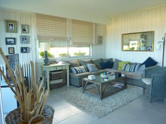 Directement en bord de mer, bel appartement en rez de jardin disposant de 3 chambres et d'un séjour très lumineux ouvrant sur le jardin et la belle plage d'Arcachon